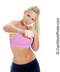 Young female fitness trainer boxing. Isolated on white