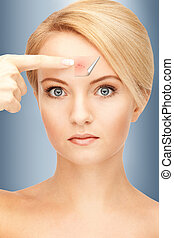no more acne - picture of beautiful woman pointing to...