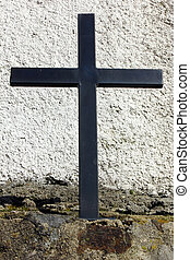 Detail of a black iron cross