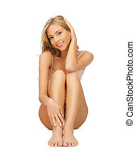 woman in cotton undrewear touching her legs - picture of...