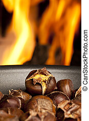 Organic Brown Chestnuts Roasting over a hot fire