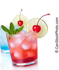Two cocktails with lime slice and maraschino. Isolated on...