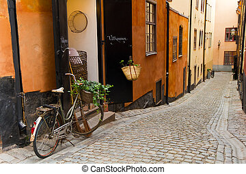 The old street in Stockholm. - The bicycle on the old street...