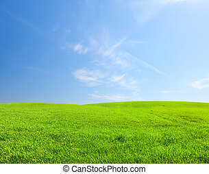 Green hill under blue sky