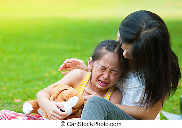 Crying little girl - Mother is comforting her crying...