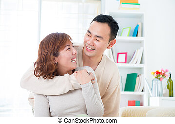 Happy Asian couple lifestyle, indoor home
