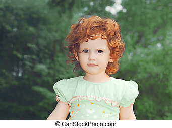 Portrait small redhaired girl