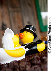 Rubber Ducks Cake - Rubber ducks sit upon chocolate cake as...