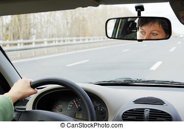 The woman drives a car