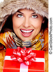 Beautiful young Christmas girl with a present. - Beautiful...