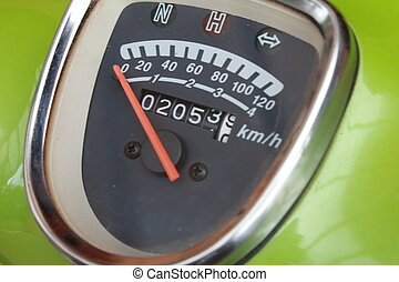 Speedometer on a bright green