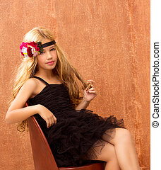 blond fashion kid girl sitting on retro vintage seat and...