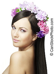 Beautiful girl with a wreath of flo