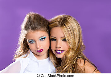 two friends fashiondoll kid girls with fashion purple makeup...
