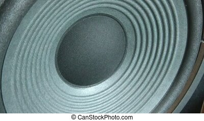 Speaker Vibrating Loud Music - Large gray speaker is...