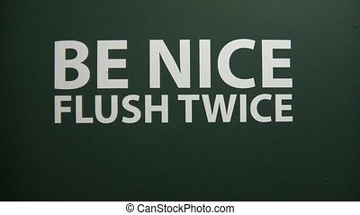 Sign Be Nice Flush Twice in Bathroom