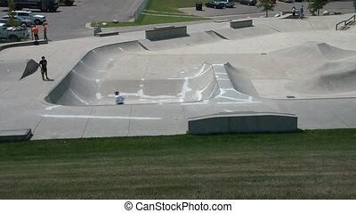 Skate Park from Atop Hill - Clip of concrete skateboard park...