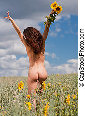 Naked girl on the field.