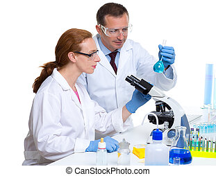 chemical laboratory with two scientist working with test...