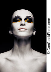 Beautiful bald futuristic unusual woman - clean shaven head....