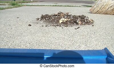 Sweeping Dirt Into Dustpan - Broom sweeps dirt and debris...