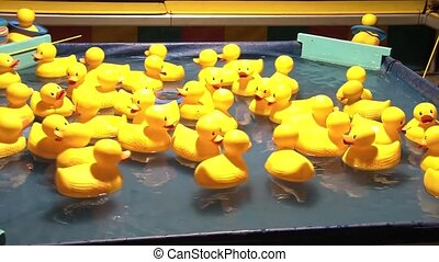 Ring Toss Onto Ducks at Fair - Brilliantly colored yellow...