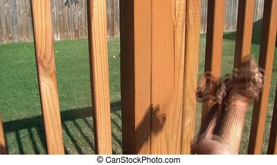 Spraying Stain Onto Deck Spindles - Spraying brown stain...