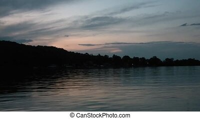 Sunset on Minnesota Lake - Clip of a pristine lake in...