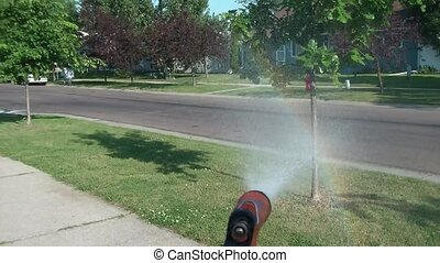 Spraying Water Hose with Rainbow - Using gun on water hose,...