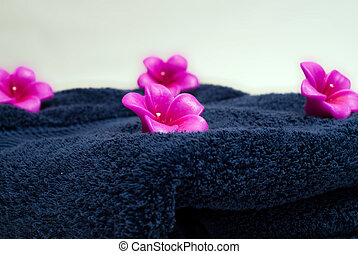 Aroma Therapy - Four flowered candles on a blue towel used...