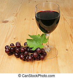 Redwine and grapes - Red wine and grapes on wooden...