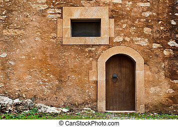 Door and Window - Door and window on a stoned wall form the...