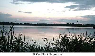 Tranquil Lake at Sunset - Tranquil lake at dusk with calming...