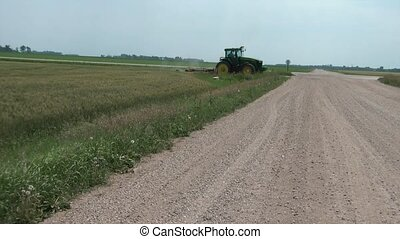 Tractor Crossing Dirt Road - Farm tractor is crossing dirt...