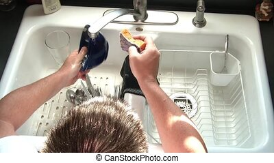Washing Dishes in Sink from Above