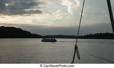 Tracking Boat at Sunset - Tracking clip of pontoon boat...