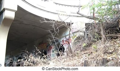 Under Railroad Bridge to Tracks Pan - Panning from top right...