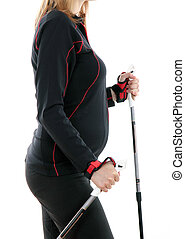 Pregnant  young woman making nordic walking