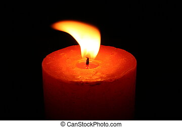 Close up of a candle with black background