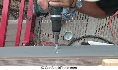 Worker Drills Hole with Torque - Shot from above,...