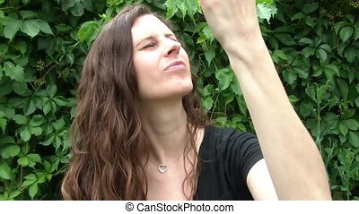 Woman Eating Cherries Sensually - Woman holds up cherries...