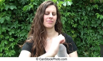Woman Drinking bottled Water - Attractive woman opening up...