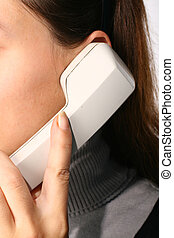 phone ring in human hand on white