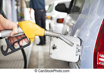 Gasoline pump refilling automobil fuel