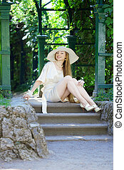 Beautiful girl in a summer park - The image of a beautiful...