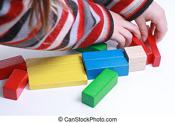 child hands play isolated toy with wooden blocks