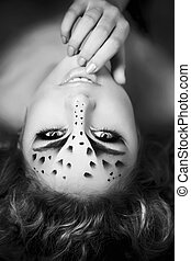 Girl with an unusual make-up as a l - The image of a...