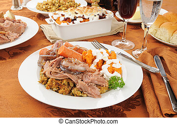 Turkey pot roast with stuffing, sweet potato casserole and...