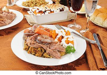 Turkey pot roast with stuffing, sweet potato casserole and...