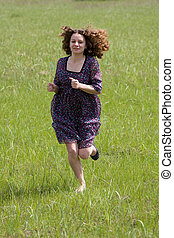 running girl on the green field